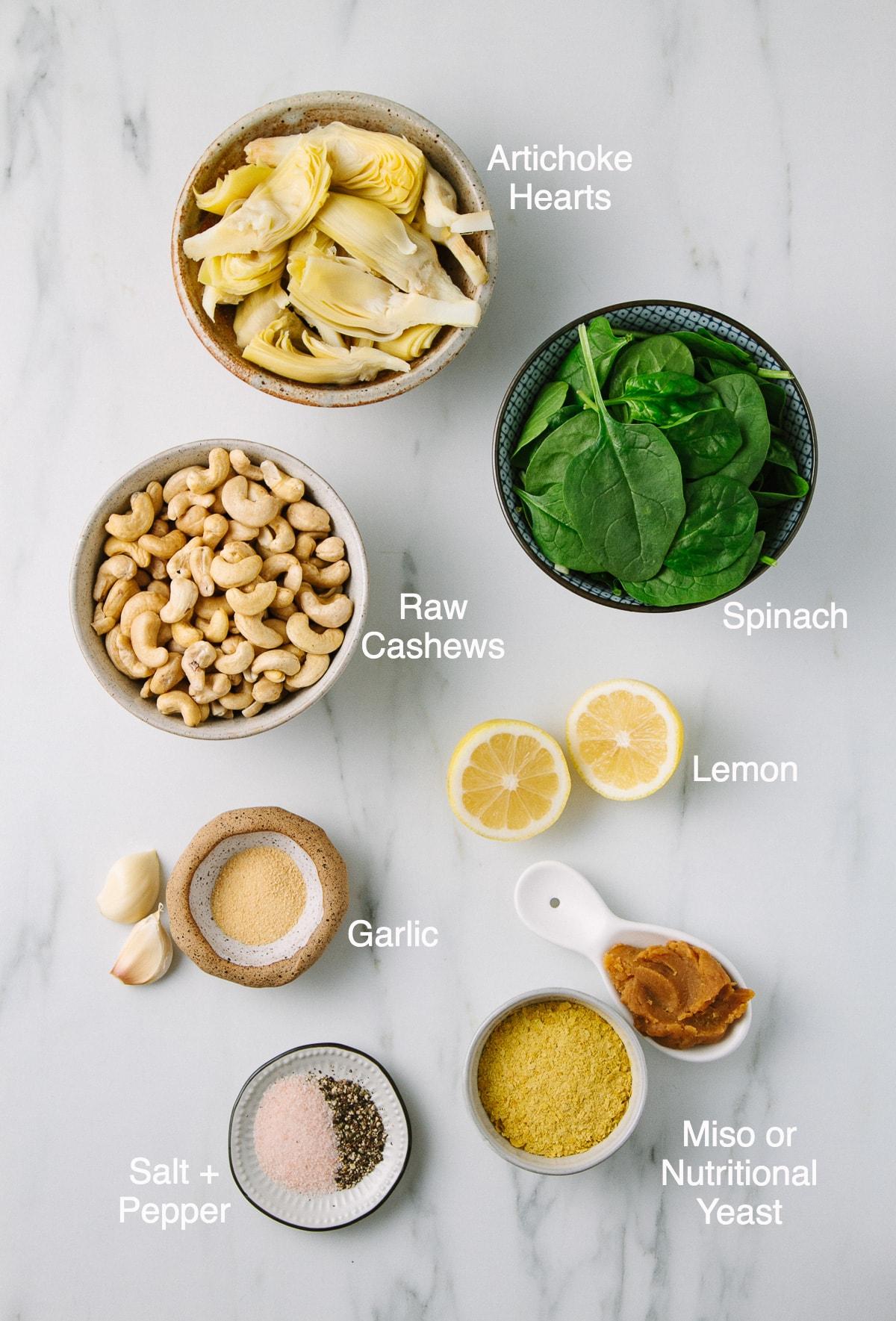 top down view of ingredients used to make vegan artichoke spinach dip.