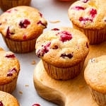 side angle view of freshly made oil free cranberry orange muffins.
