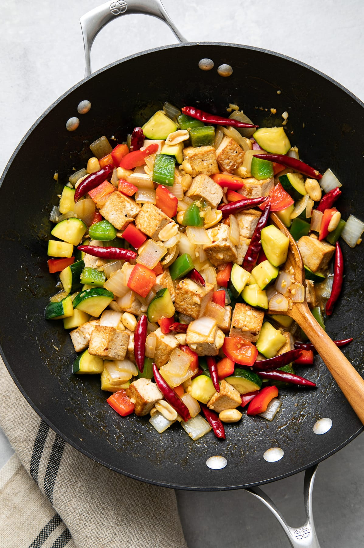 top down view of freshly made kung pao tofu in a wok.