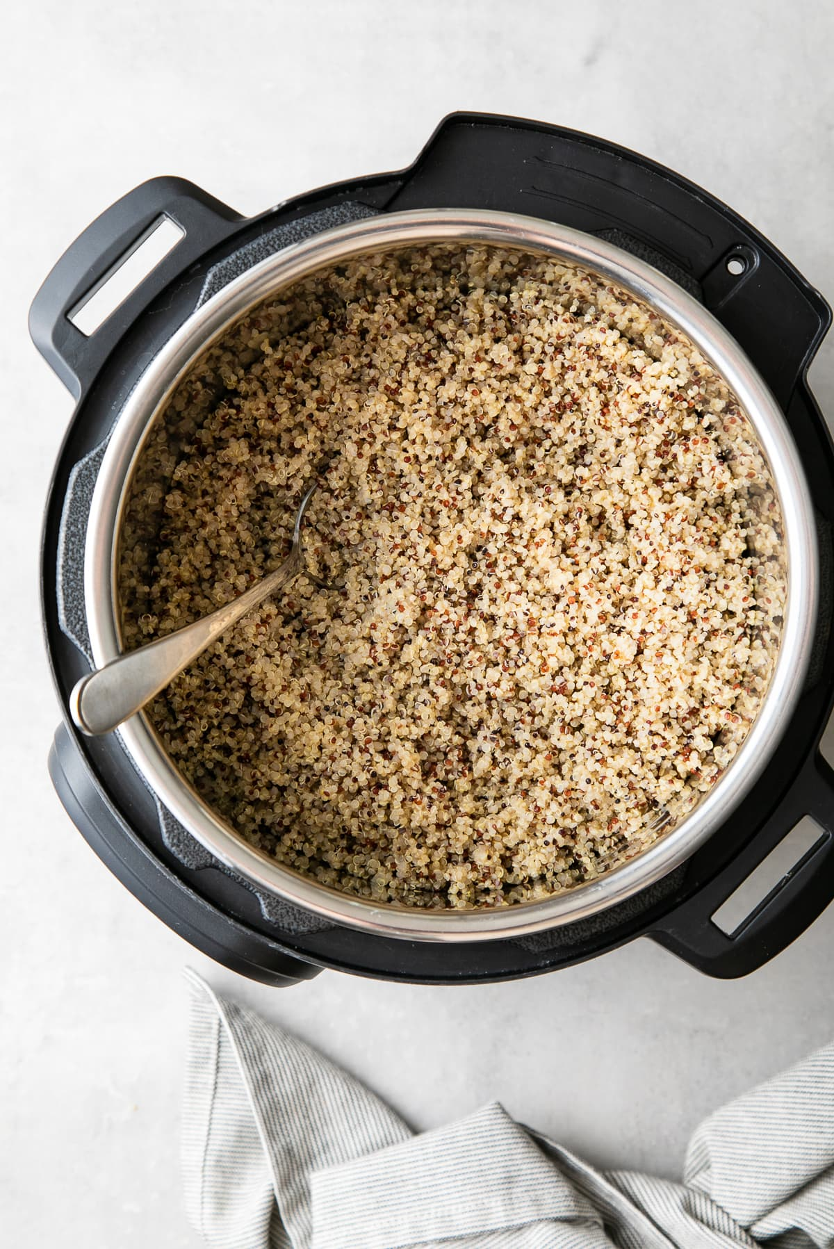 top down view of freshly made quinoa in an instant pot.