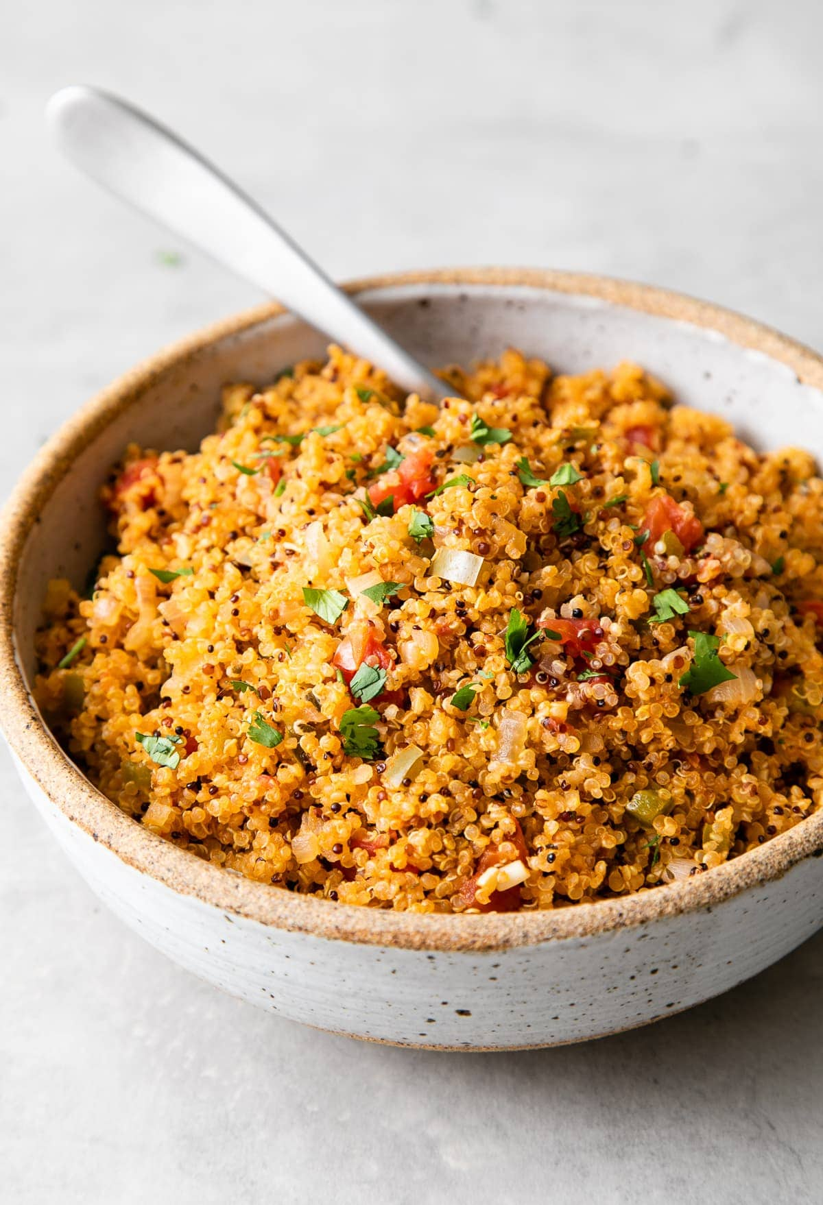 side angle view of healthy quinoa Spanish rice in a serving bowl.
