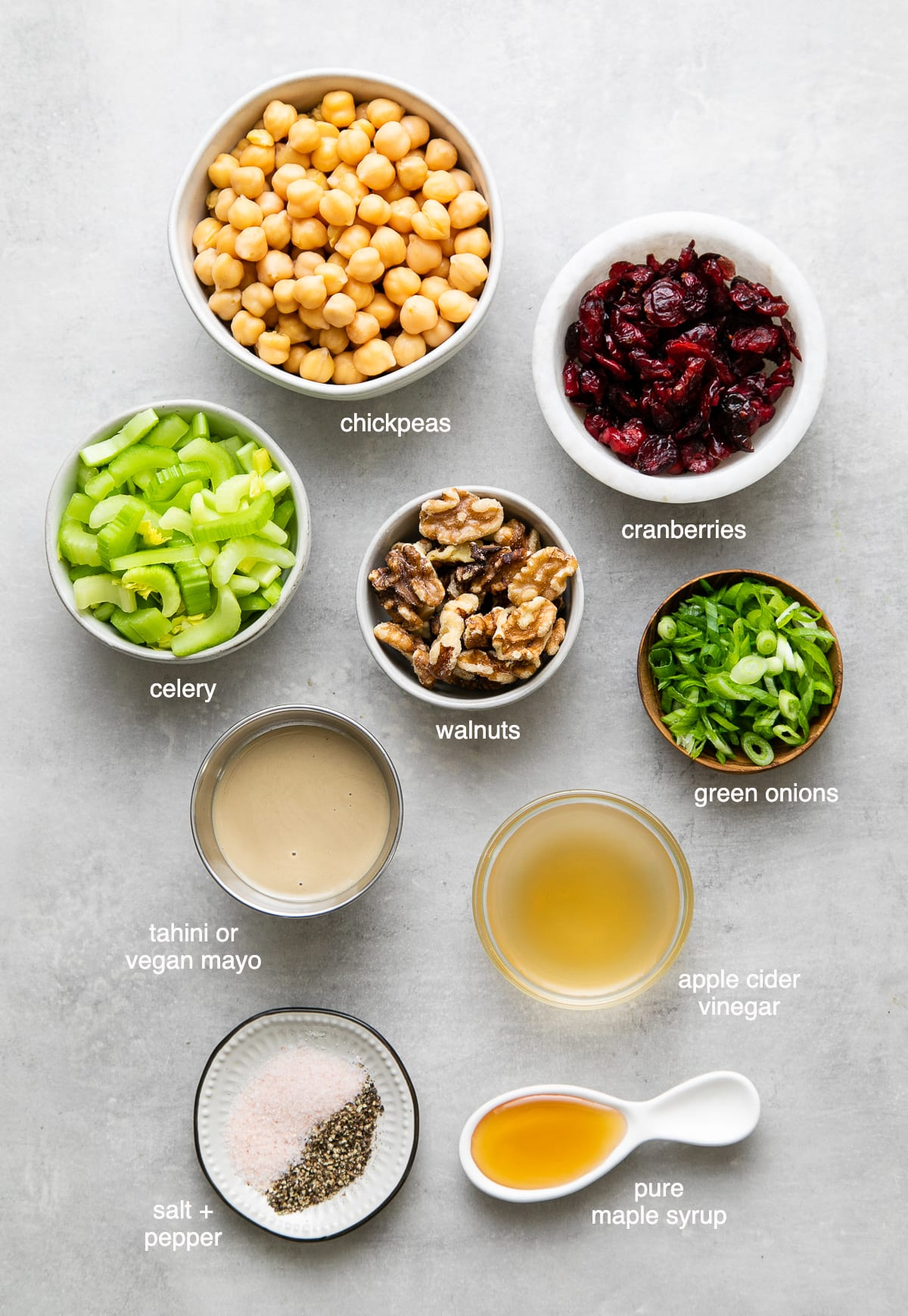 top down view of ingredients used to make the best vegan chicken salad with cranberries, chickpeas and walnuts.