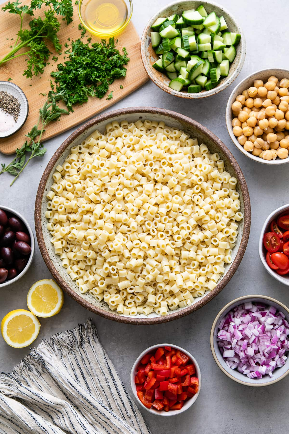top down view of ingredients for Greek pasta salad prepped and ready to be combined.