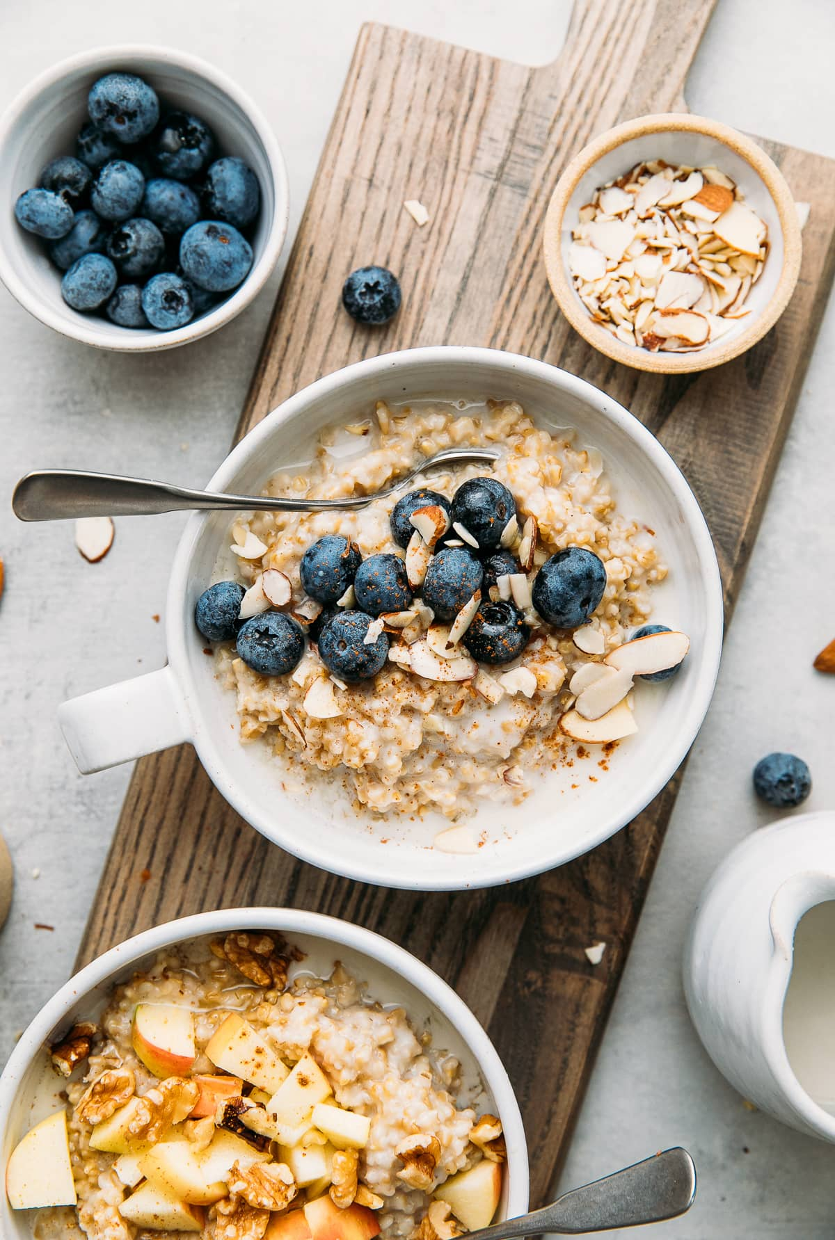 top down view of 2 healthy bowls of Instant Pot steel cut oats in a bowl with flavor topping.