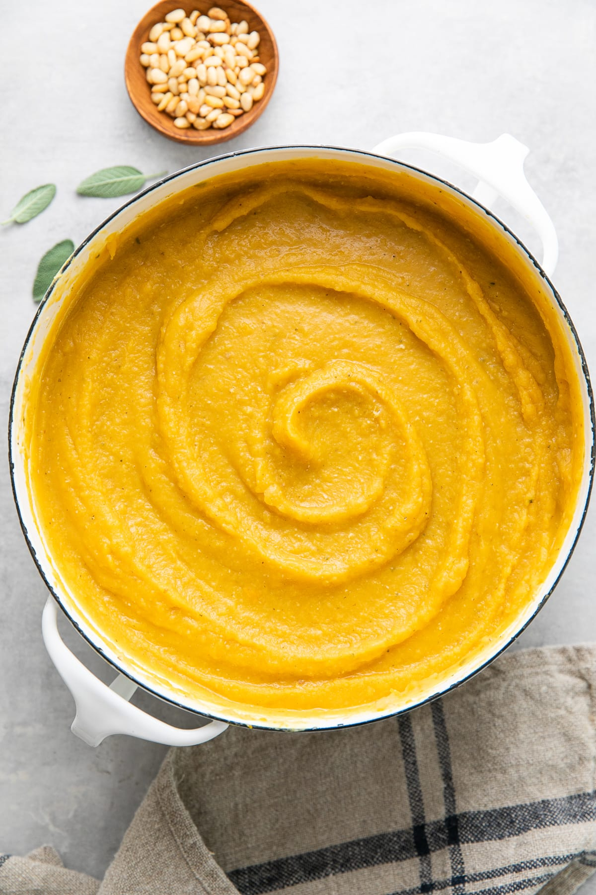 top down view of white pot with freshly made healthy butternut squash red lentil soup.