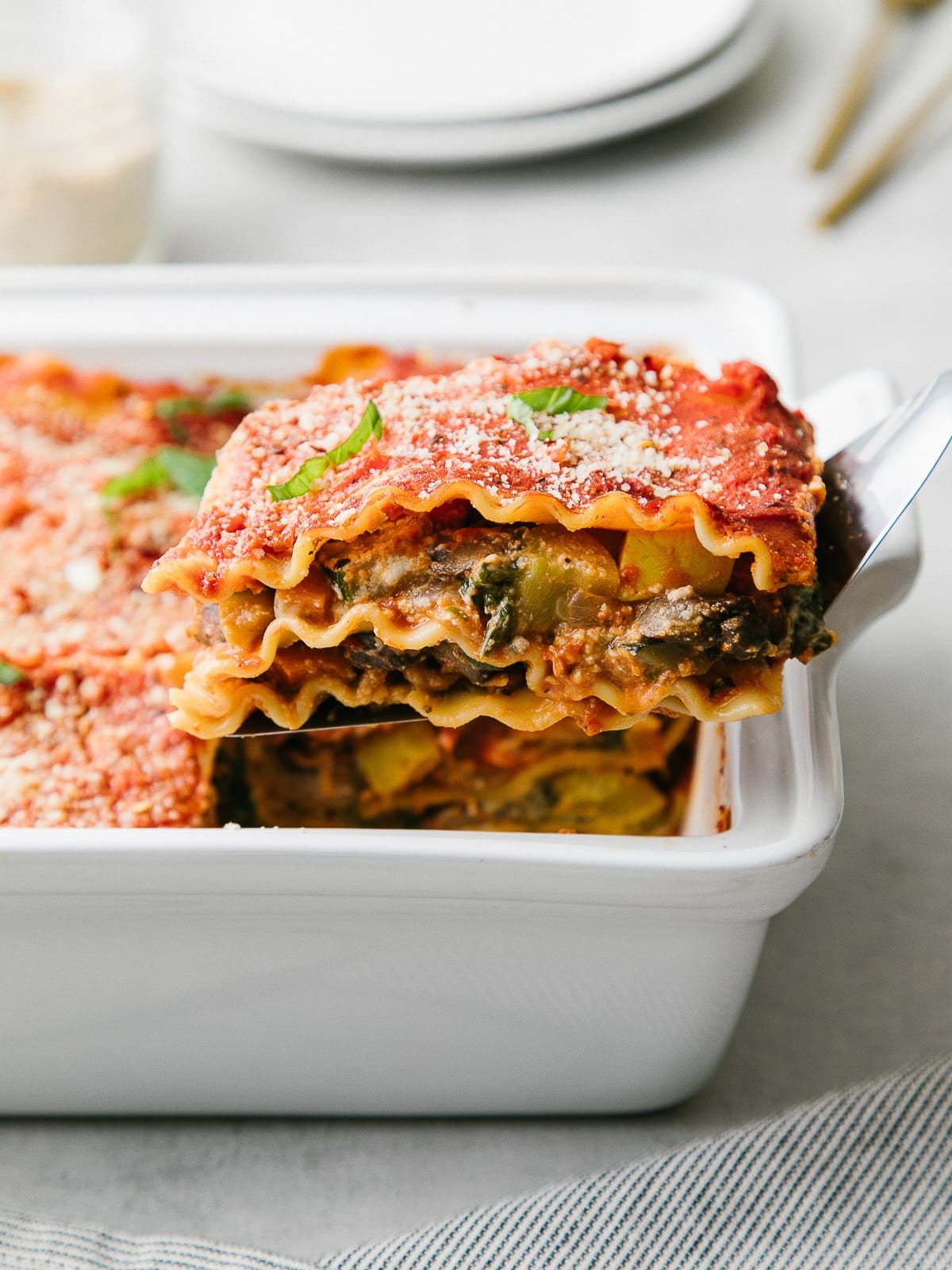 head on view of vegan lasagna on a spatula.