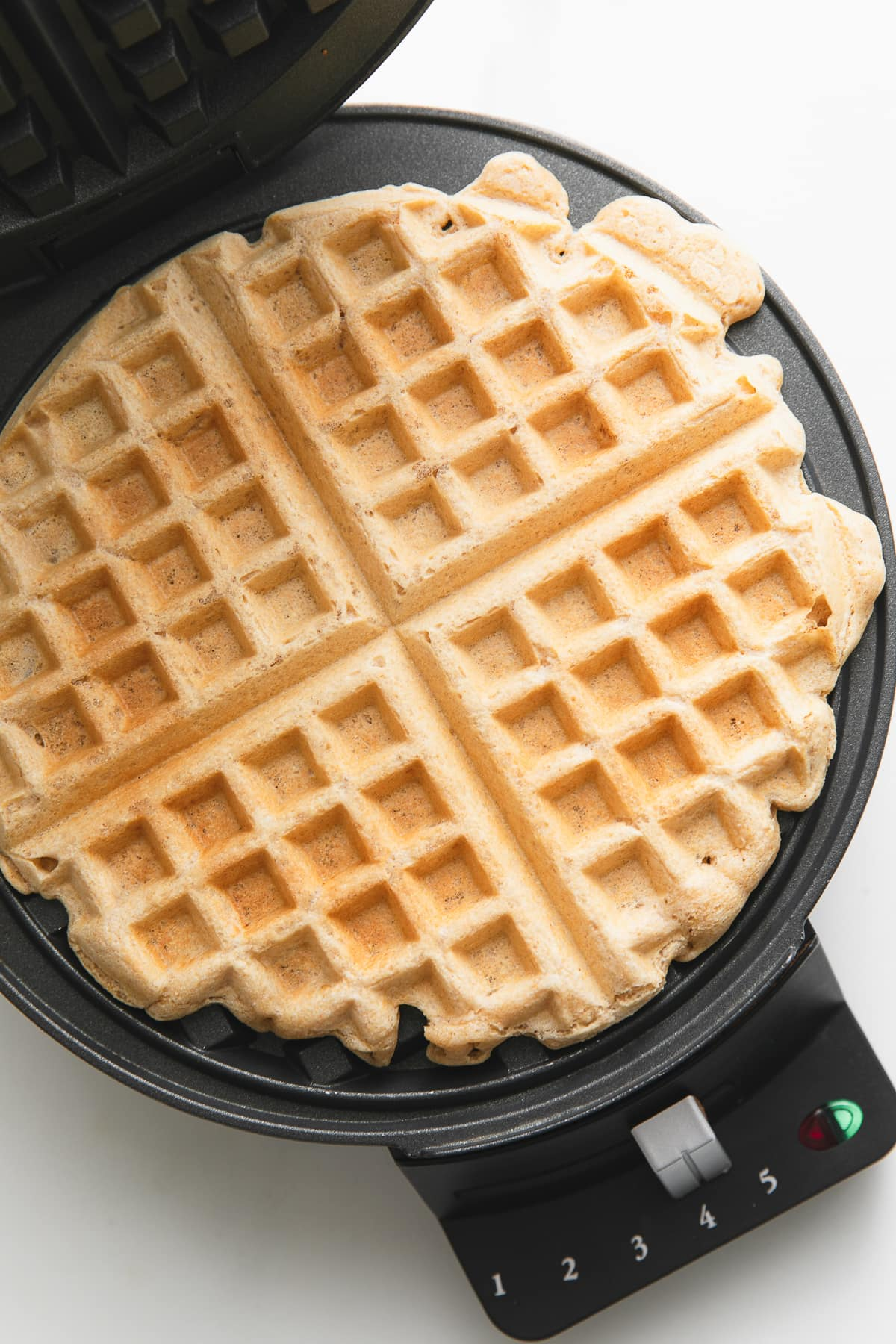 top down view of vegan waffle on waffle iron.