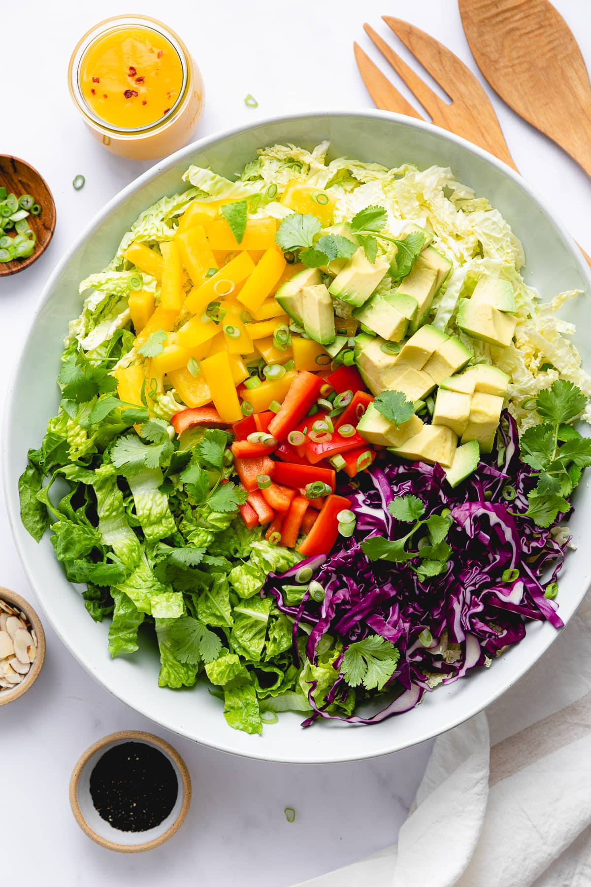 top down view of ingredients for chop chop salad added to bowl.