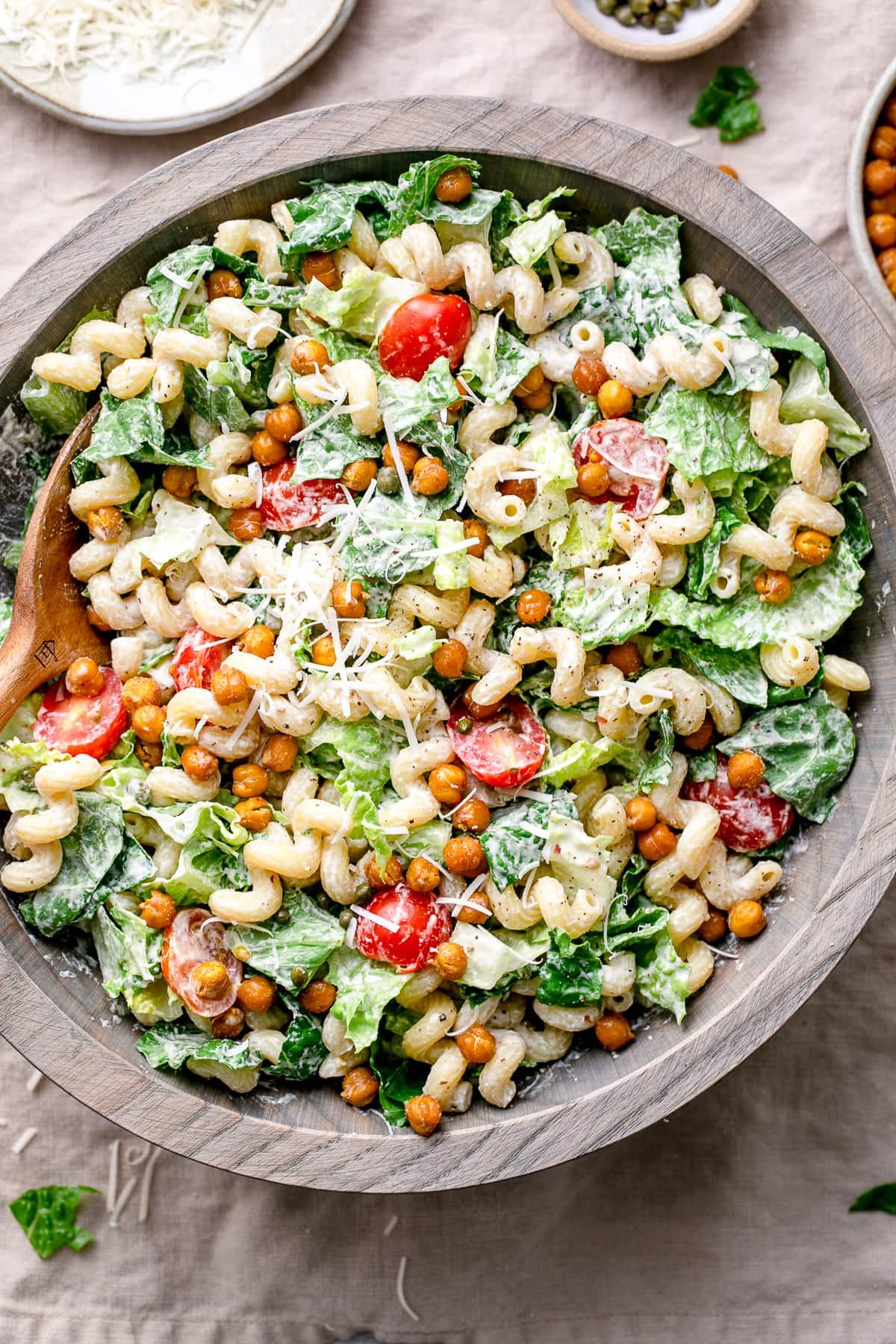 top down view of serving bowl with healthy vegan caesar pasta salad.