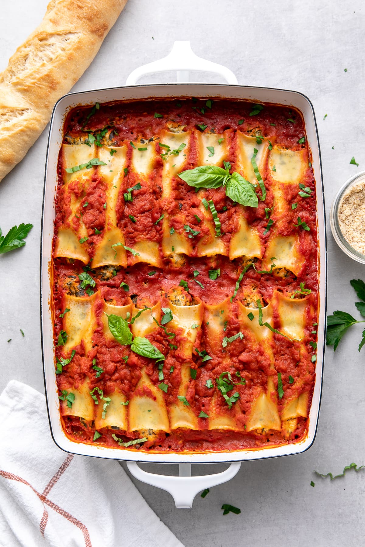 top down view of freshly baked vegan cannelloni in a baking dish.
