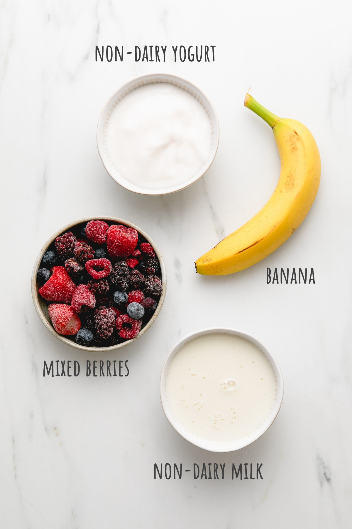 top down view of ingredients used to make mixed berry yogurt smoothie recipe.