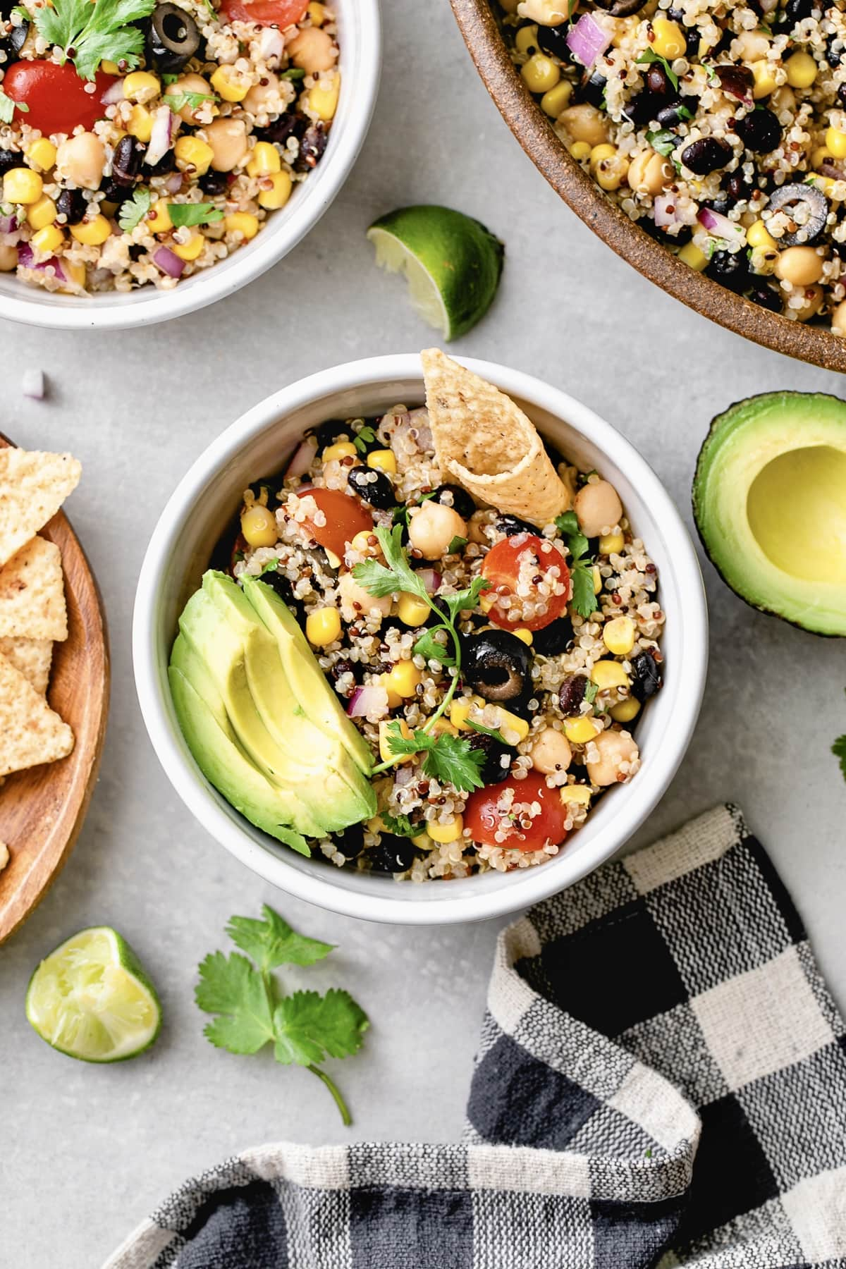 top down view of southwest quinoa salad in a bowl with items surrounding.