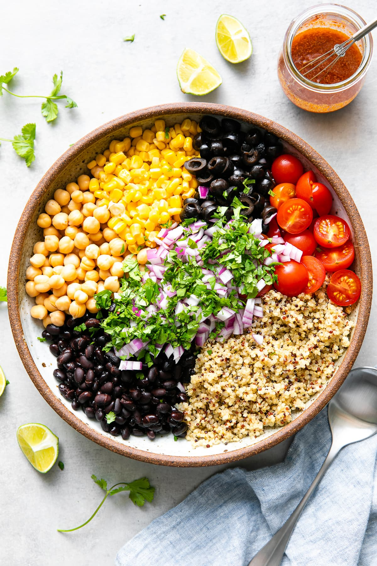 top down view of bowl filled with ingredients used to make southwest quinoa salad.