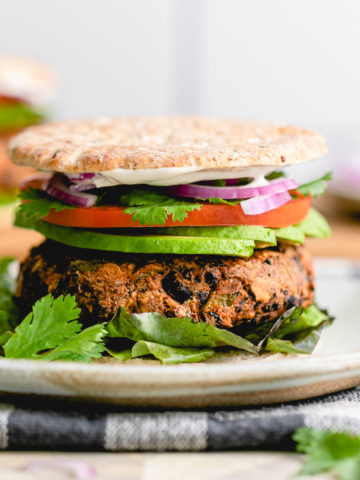 head on view of plated santa fe vegan black burger.