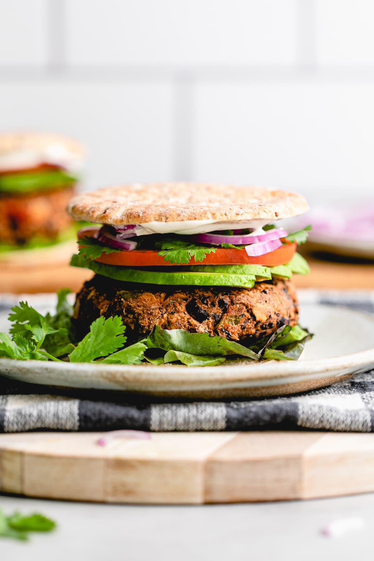 head on view of plated vegan black burger.
