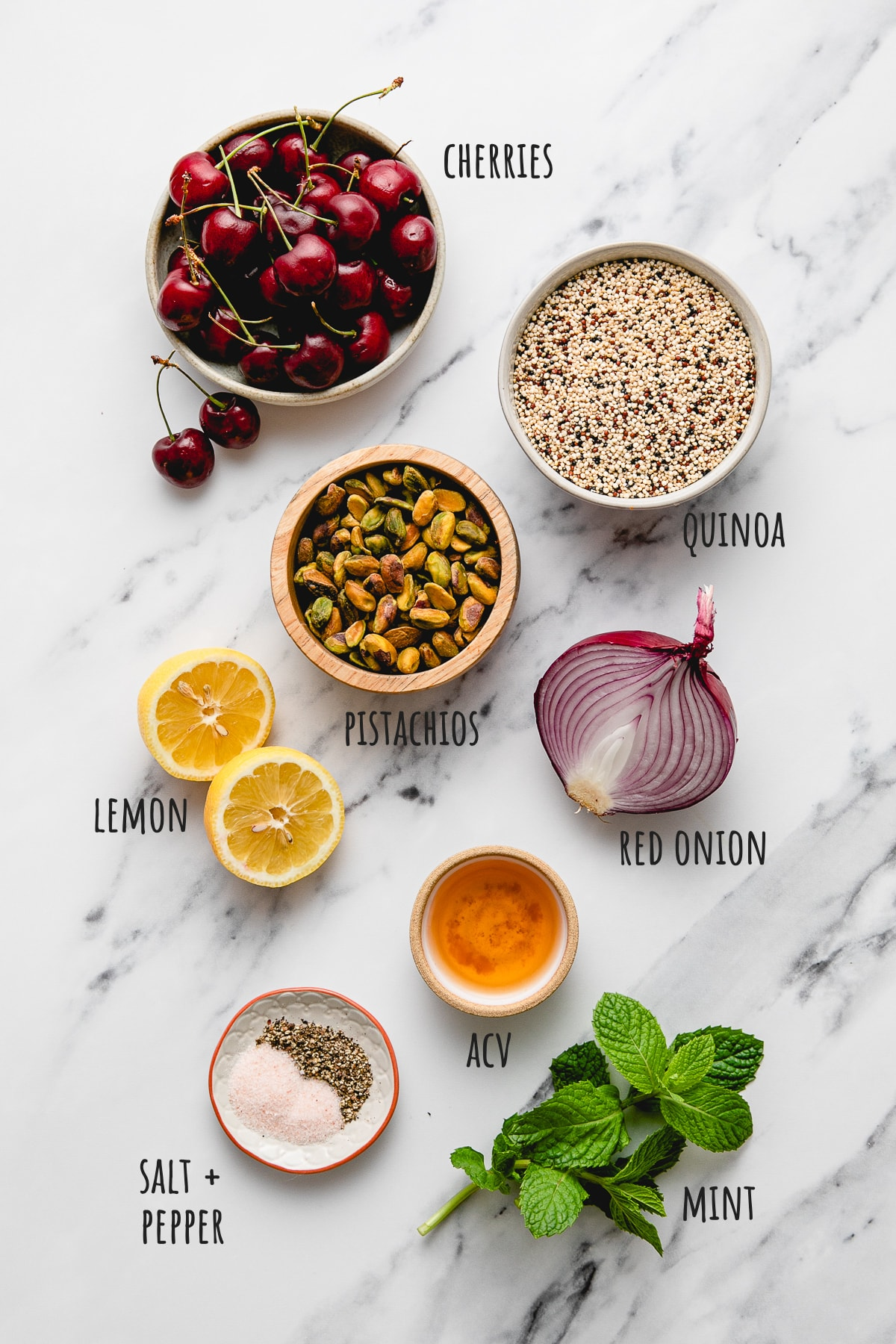 top down view of ingredients used to make cherry pistachio quinoa salad recipe.