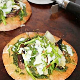 spring veggie pizza made with spinach pesto simpleandsavory.com