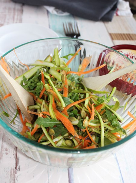shaved asparagus salad with creamy garlic dressing in a bowl