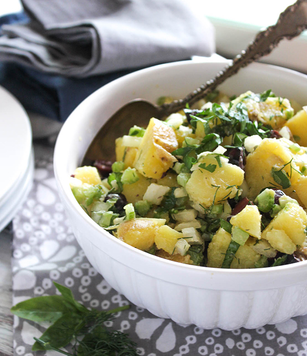 a close up of healthy potato salad in a bowl