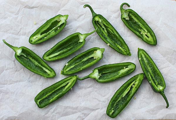 unstuffed jalapeno peppers on a board
