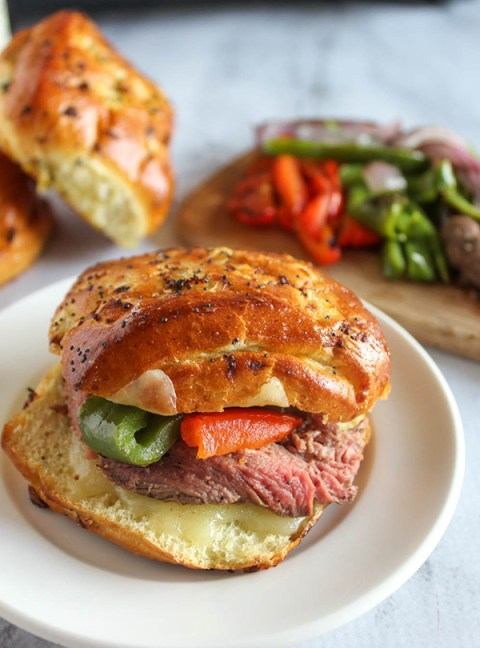 homemade cheesesteak sandwich on a soft onion roll