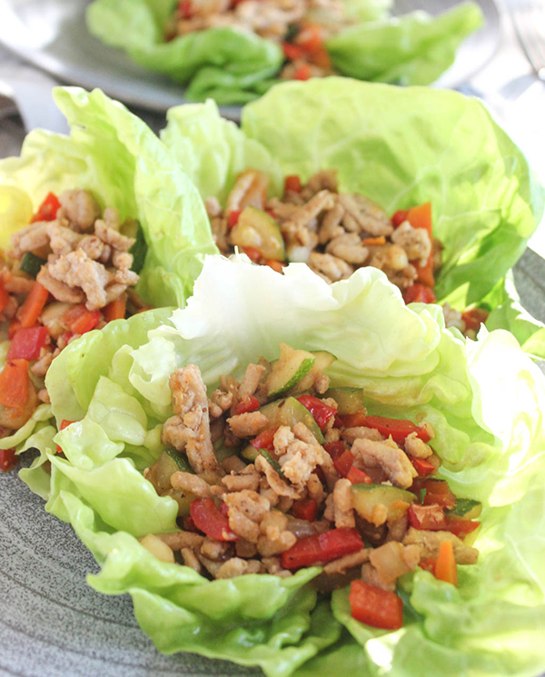 Asian Chicken Lettuce Wraps with vegetables on a plate