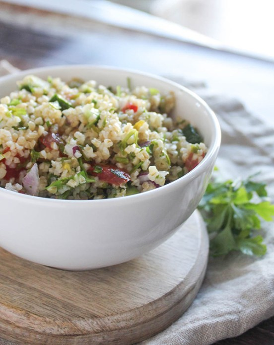 tabbouleh saald in a bowl with a side of parsley