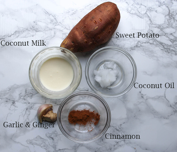 All of the ingredients for the sweet potato mash, sweet potato, coconut milk, coconut oil, garlic, ginger and cinnamon