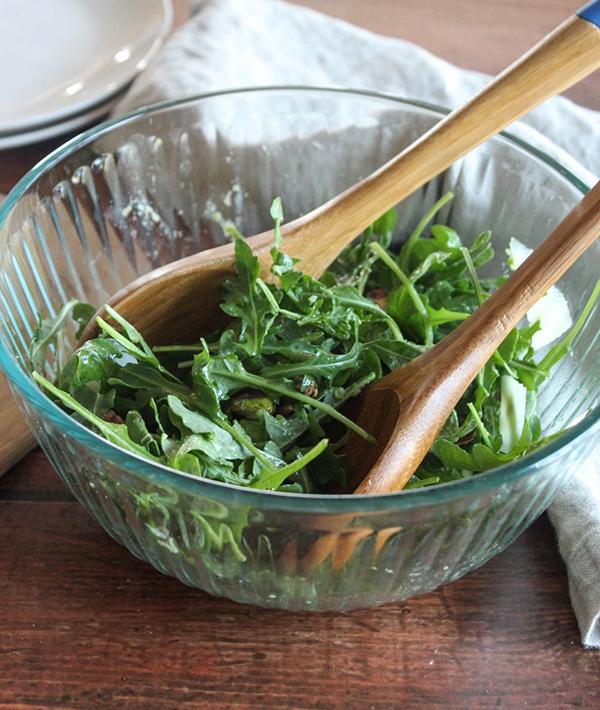 Baby arugula salad in a glass bowl