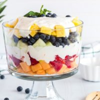 summer fruits with creamy lime dressing in a trifle bowl