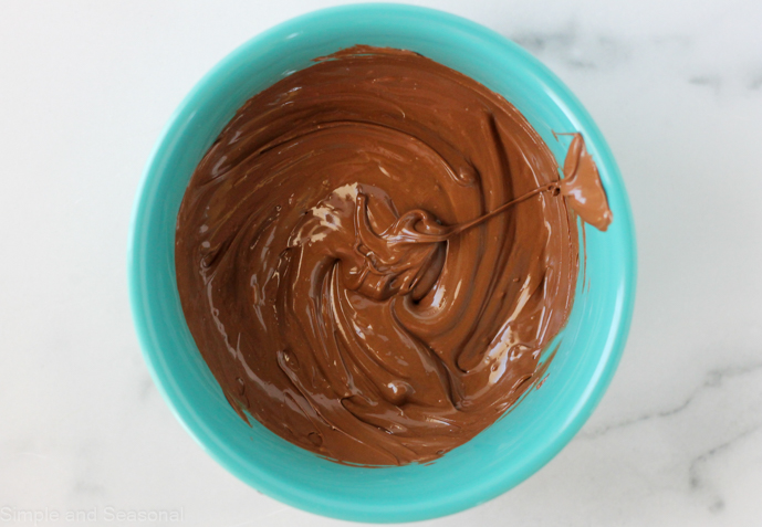 melted milk chocolate in a blue bowl