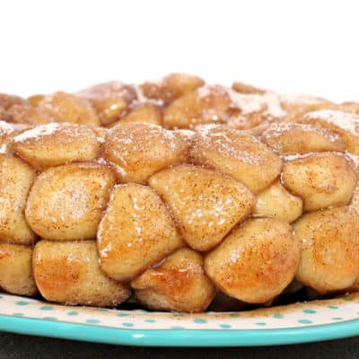 Made with frozen dinner roll dough, Rhodes Rolls Monkey Bread really is the best. The fluffy chunks of bread are covered in cinnamon and sugar and baked in a gooey, butter sauce that makes this perfect for breakfast or dessert!
