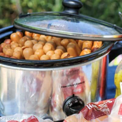 Not everyone wants to be stuck behind a grill during the picnic! If you have to cook hot dogs for a crowd, there's an easy way to do it-in the slow cooker! Crockpot Hot Dogs are a thing, and they are delicious!