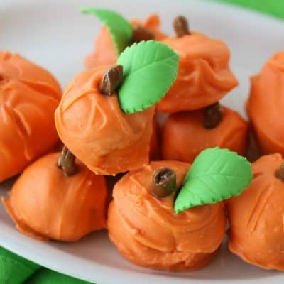 Made with spice cake and cream cheese frosting, these Cake Ball Pumpkins are a perfect party treat for Halloween, Thanksgiving or the Fall Festival!