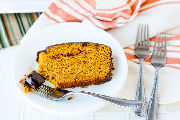 slice of pumpkin bread on a plate with a piece on the fork