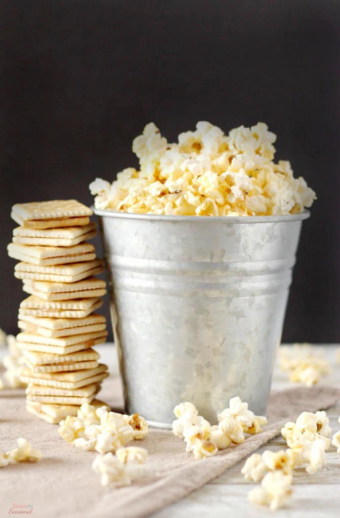 popcorn and crackers on a table