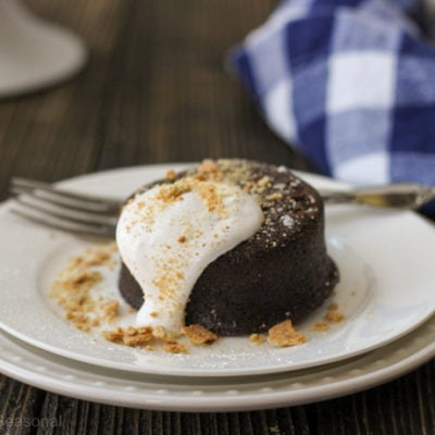 s'mores lava cake on a white plate with napkin in the background