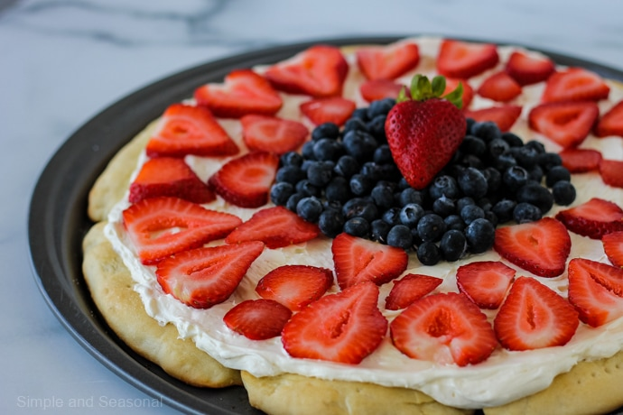 strawberries and blueberries on a rhodes roll crust