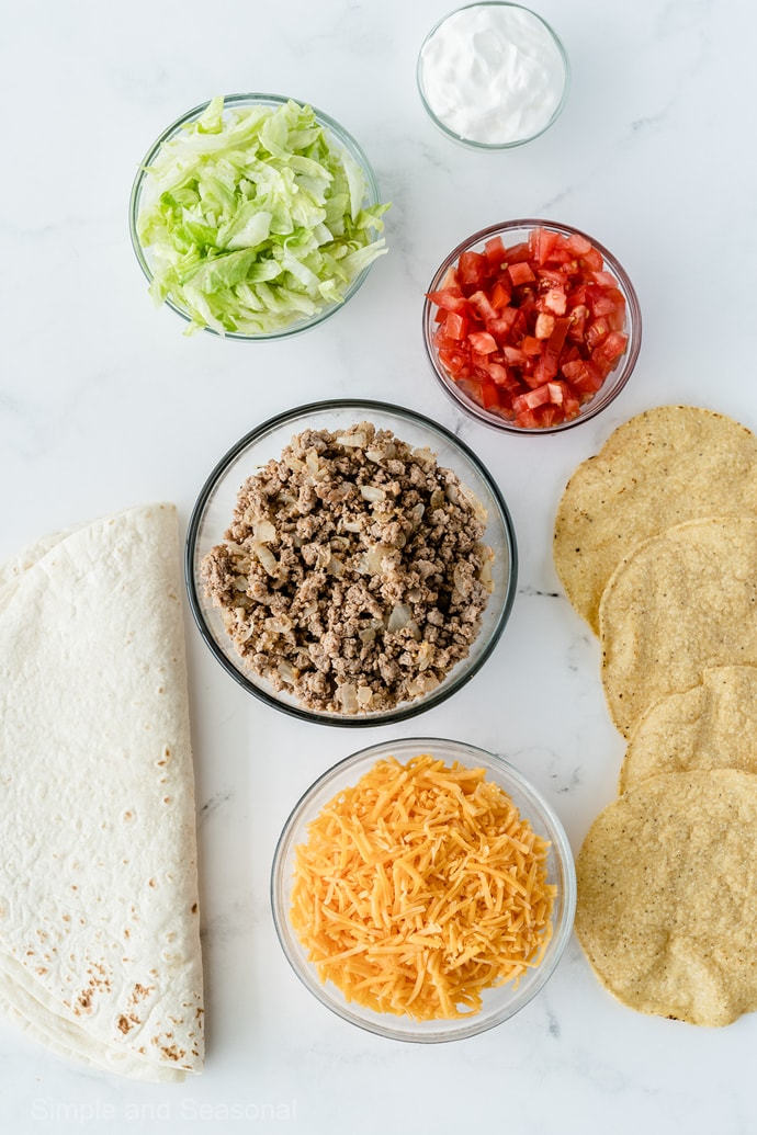 ingredients: ground beef, cheese, lettuce, tomatoes, flour and corn tortillas