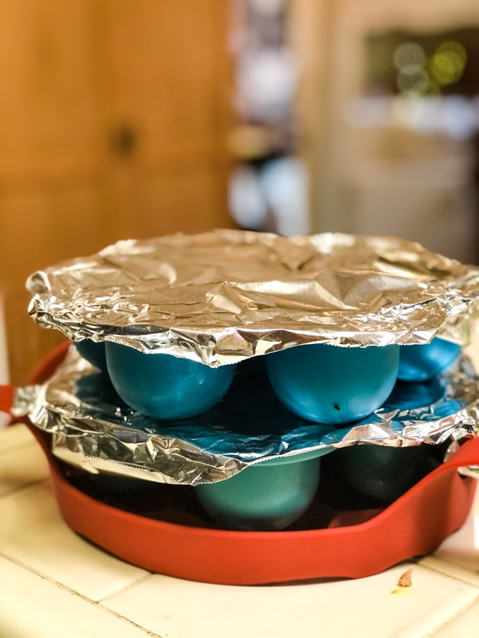 egg bite molds covered in foil and stacked on each other