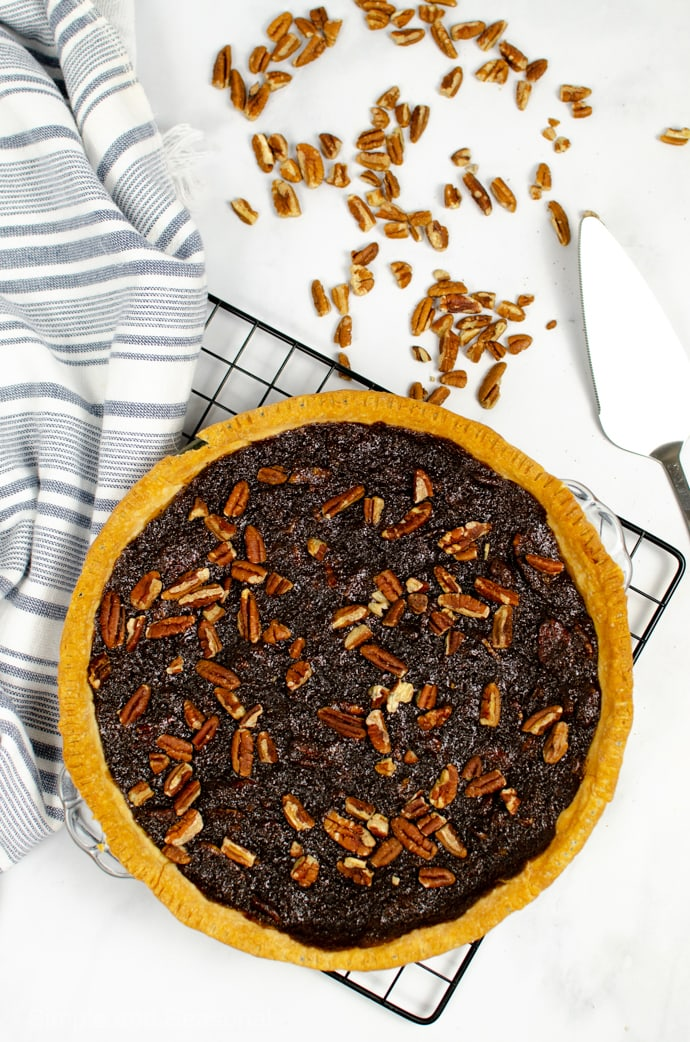 baked chocolate pecan pie on a cooling rack