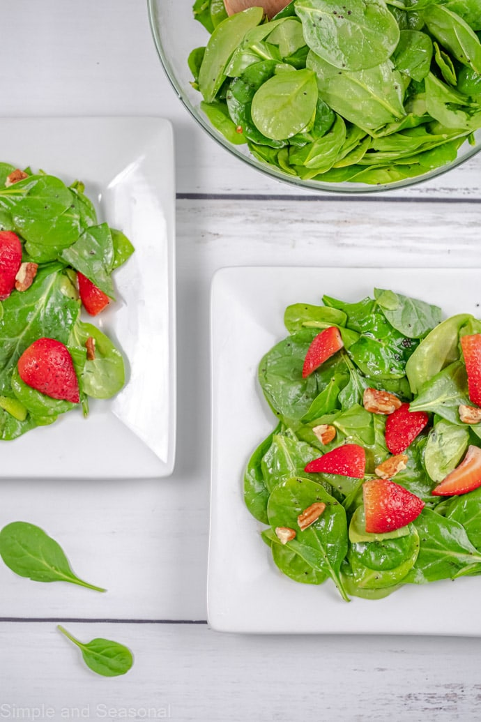 top down view of two plates of salad