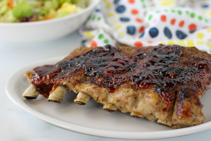 cooked ribs on a white plate