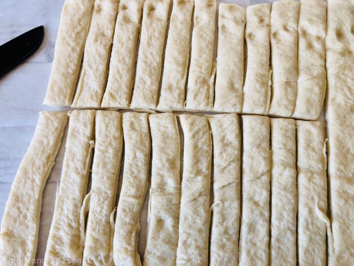 rolled out pizza dough cut into strips