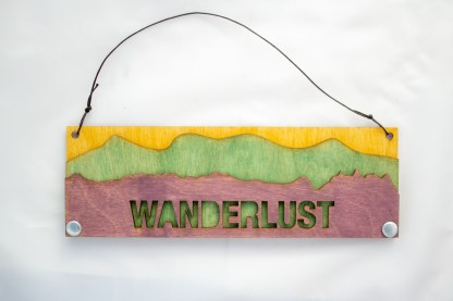 Wanderlust Text Sign with Mountains