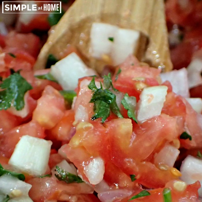 mixing fresh salsa