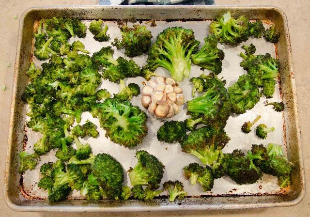 Roasted Broccoli and Roasted Garlic in a half sheet pan