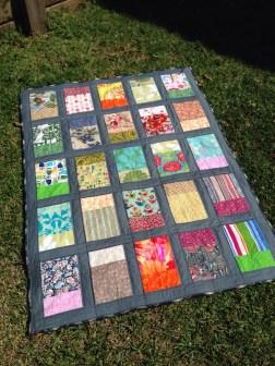 """Windows"" quilt on lawn"