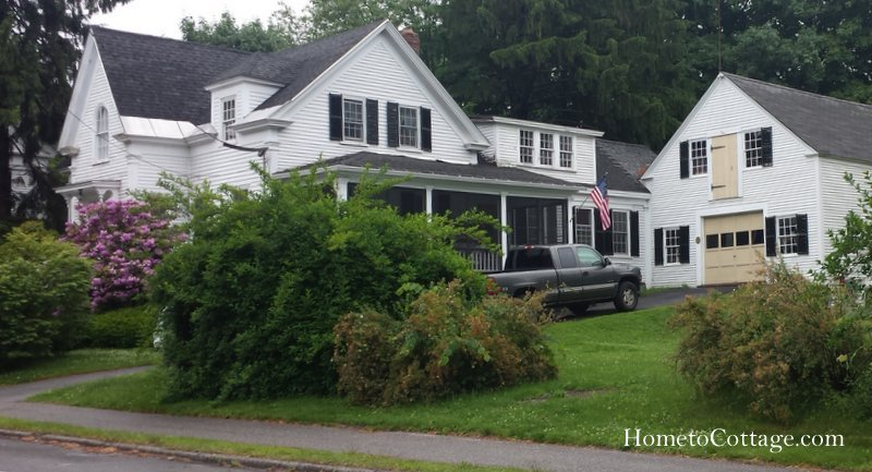 HometoCottage.com white barn with tan doors