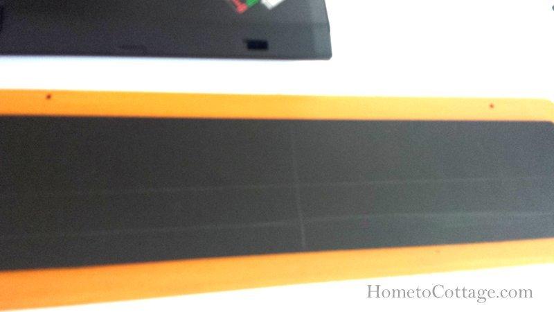 HometoCottage.com lines on chalkboard arrow